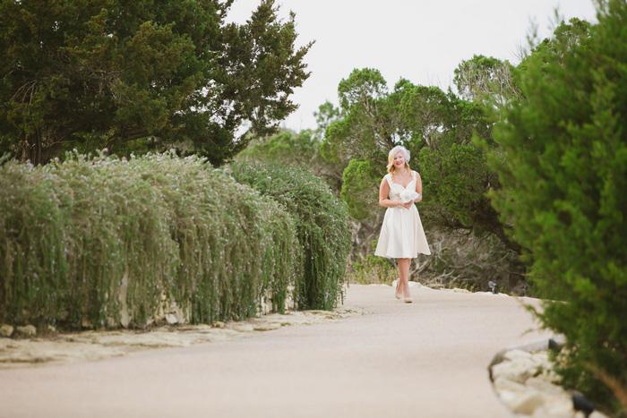 bride walking towards chapel