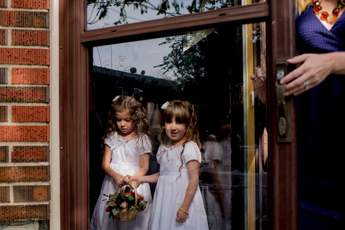 flower girls waiting in doorway