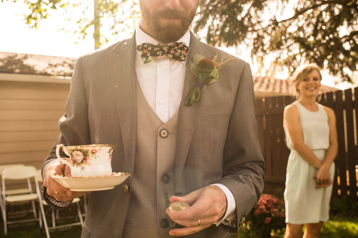 groom in floral bow tie