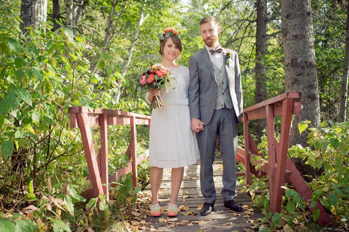 bride and groom portrait on bridge