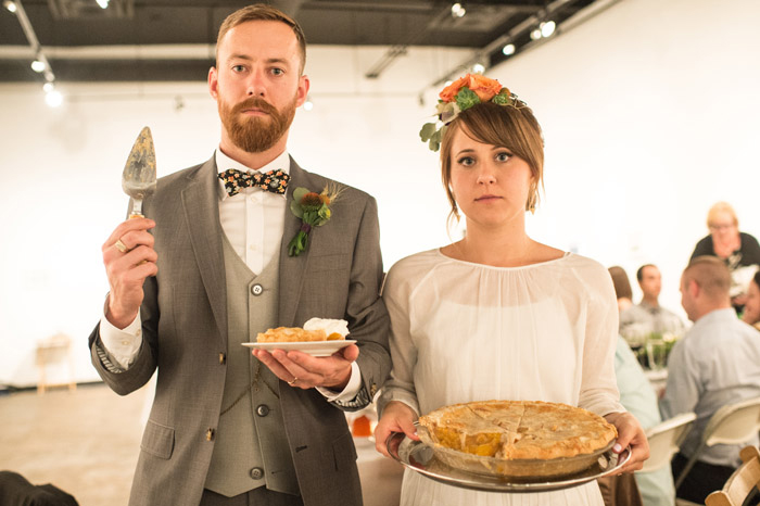 bride and groom with pie