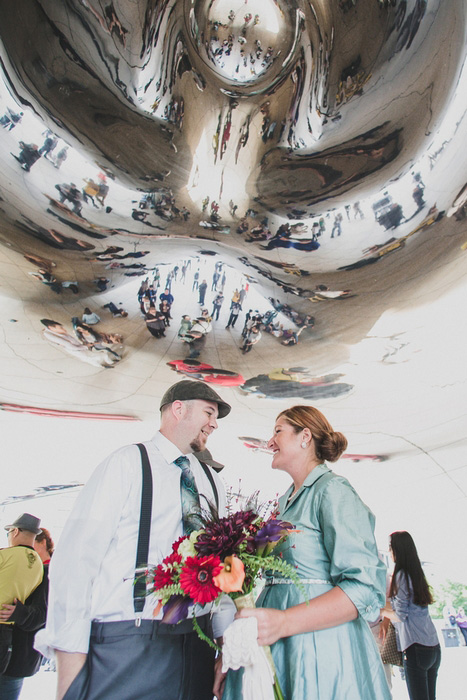 bride and groom under art installation