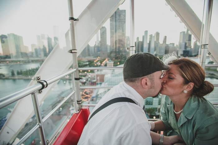 bride and groom kissing on Ferris Wheel