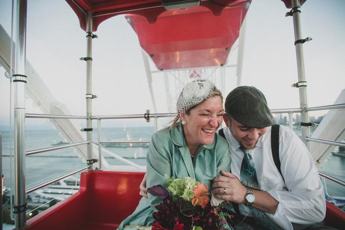 bride and groom on Ferris wheel