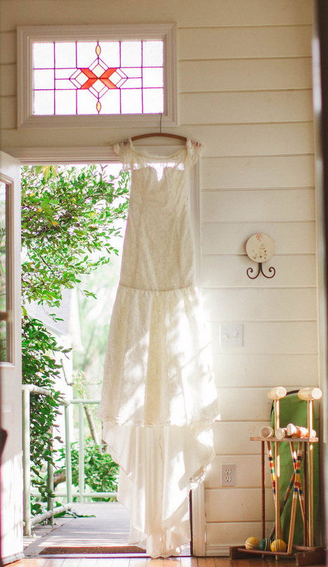 Wedding dress hangin in doorway