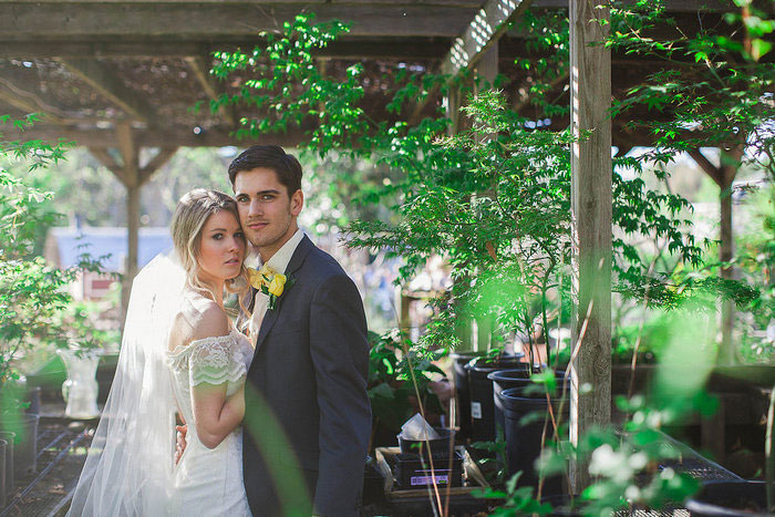 bride and groom on flower farm