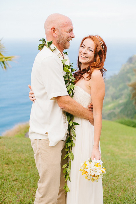 bride and groom portrait on cliff by the ocean