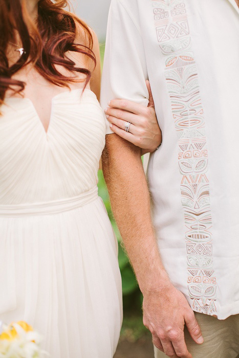 bride and groom linking arms