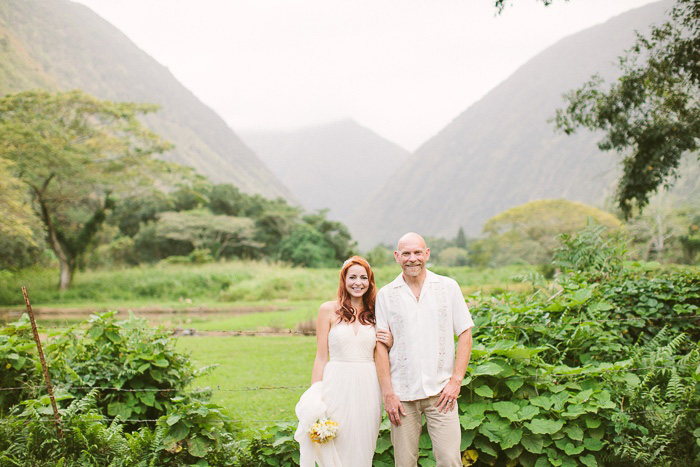 bride and groom portrait in front of Hawaiian mountains