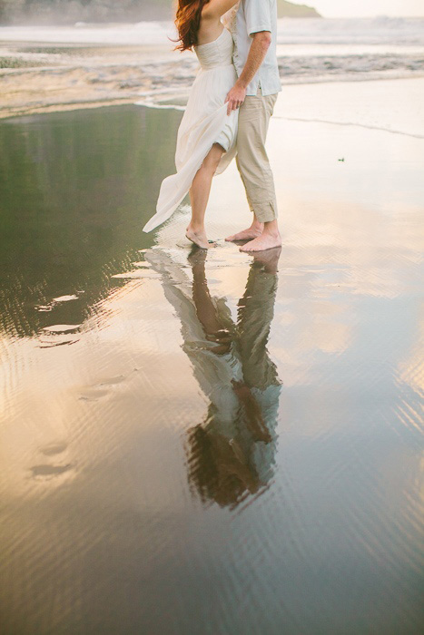 bride and groom reflection in the water