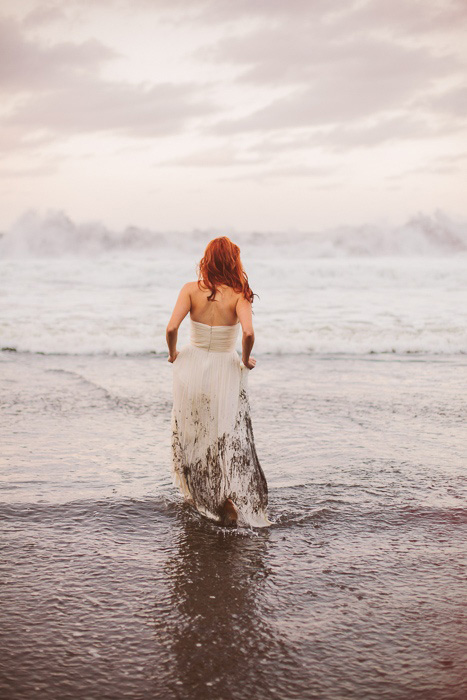 bride walking into the ocean
