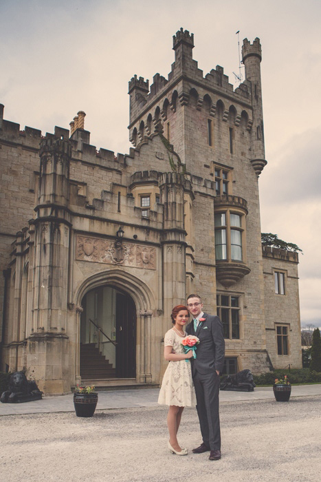 bride and groom outside irish castle