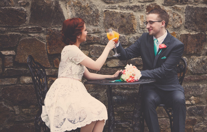 bride and groom drinking mimosas