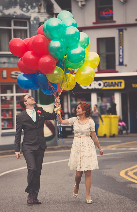 bride and groom with lots of balloons