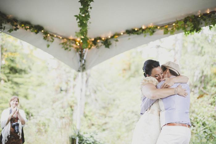 brides hugging on dance floor