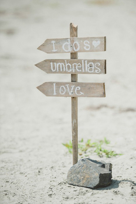 wooden wedding signs on the beach