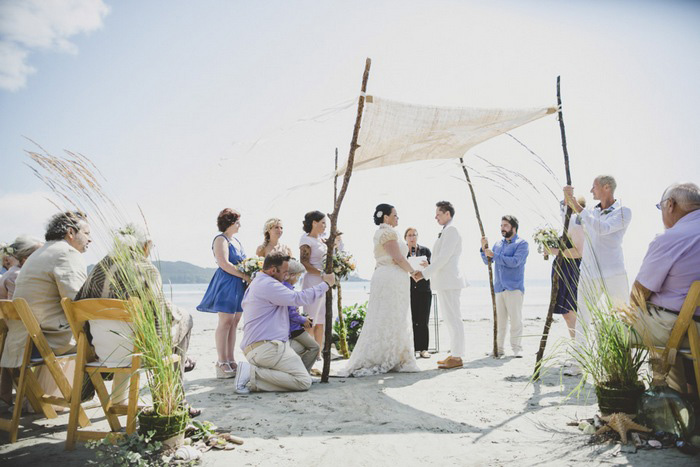 beach wedding ceremony under canopy