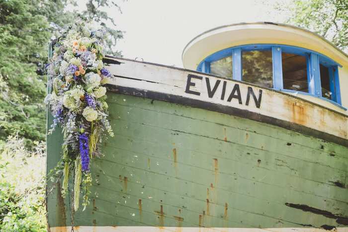 wooden boat decorated with wedding flowers
