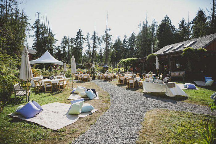 outdoor wedding reception with blankets and pillows