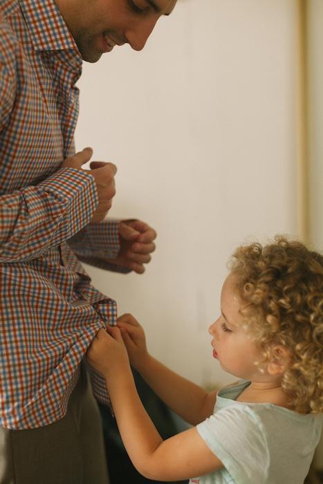 daughter helping groom get ready