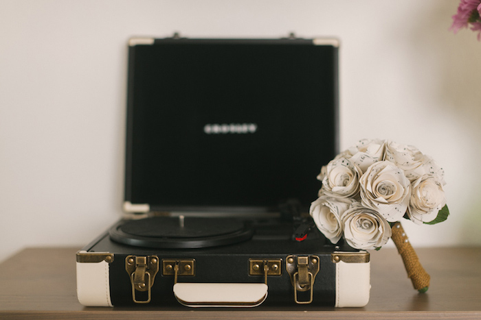 paper flower bouquet on record player