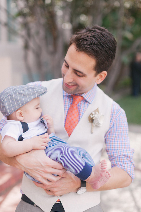 groom holding baby son