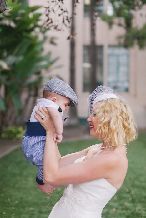 bride holding baby son