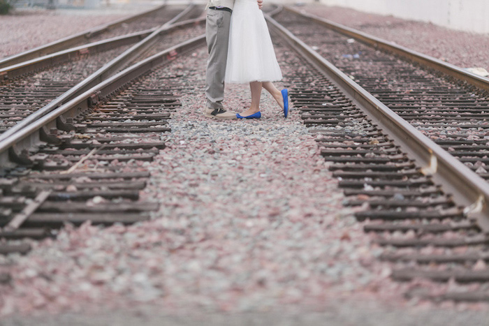 bride and groom on train tracks
