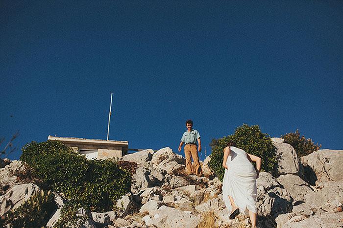 bride climbing cliff