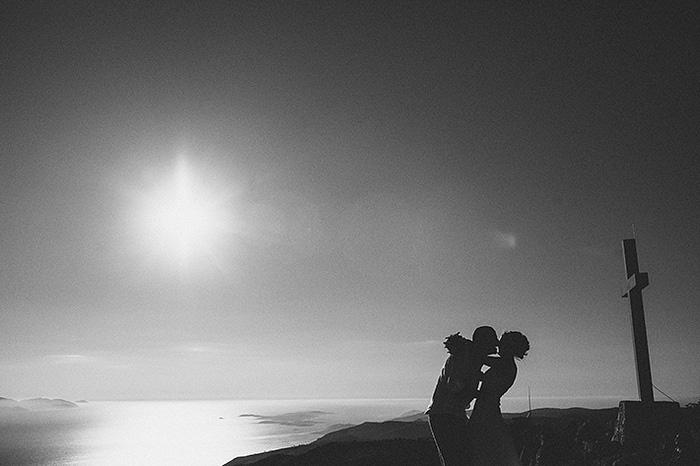 bride and groom kissing in Croatian countryside