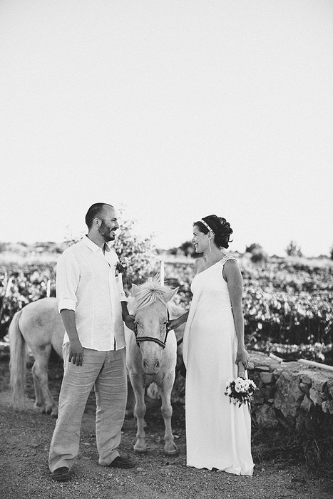 bride and groom portrait with horse