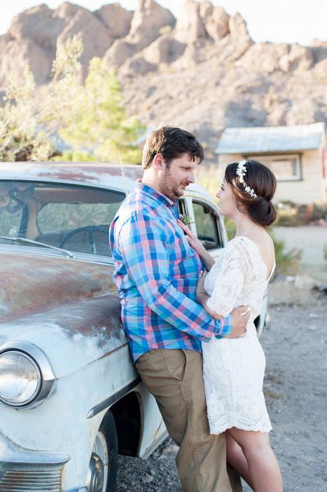 bride and groom next to vintage car