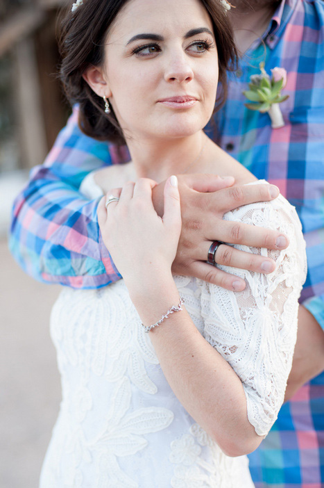 portrait of bride and groom's rings