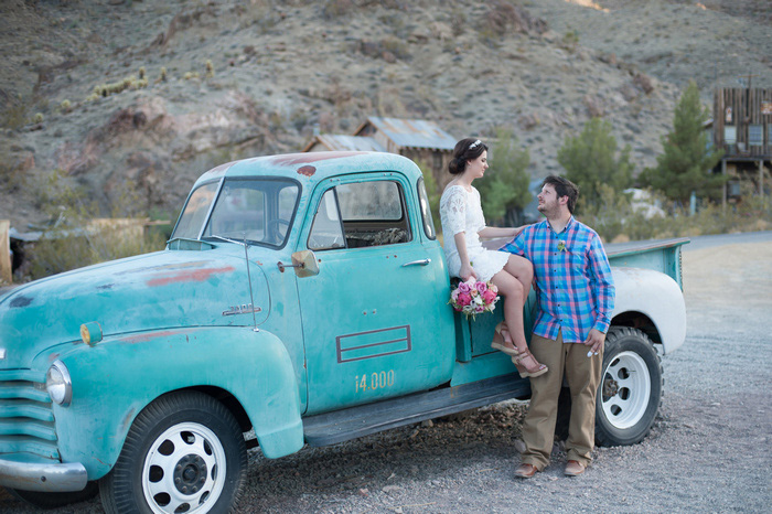 bride and groom portrait with blue vintage pick-up