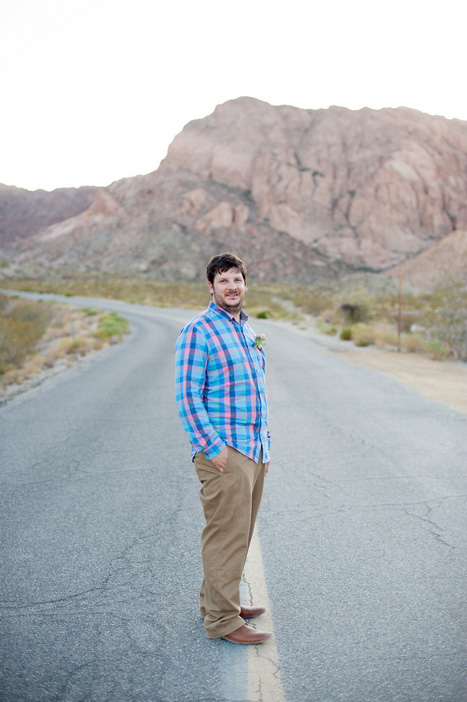 groom in middle of desert highway