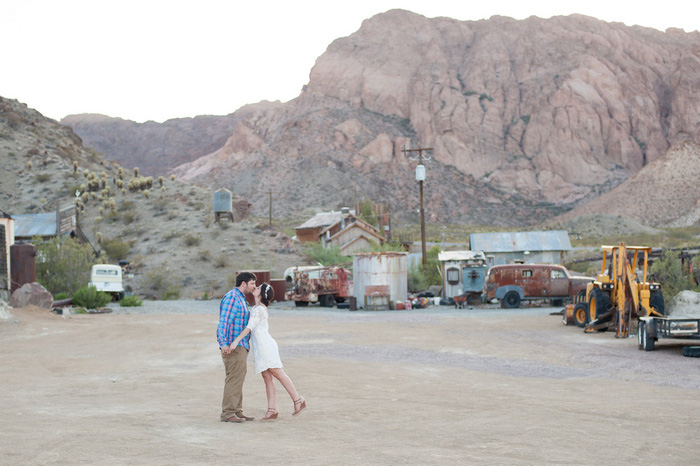 bride and groom kissing in the desert