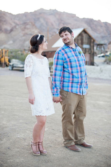 bride and groom walking in the desert