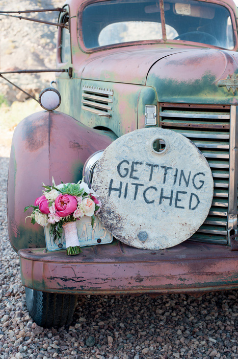 getting hitched sign on old truck in desert