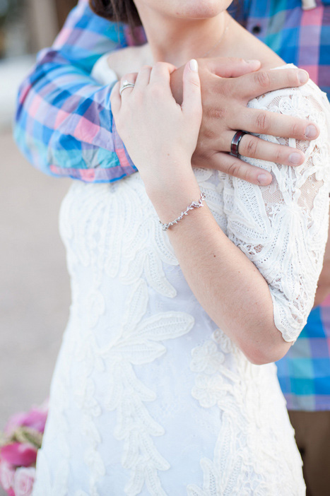 close-up of bride and groom's hands