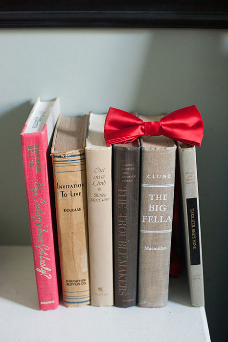 red bow tie on books