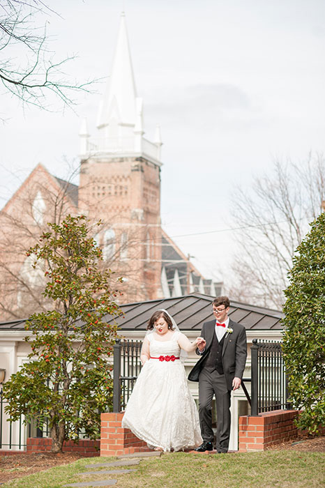 bride and groom walking on property