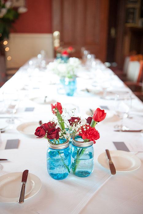 red flowers in blue jar