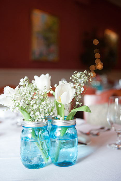 white tulips in blue jar