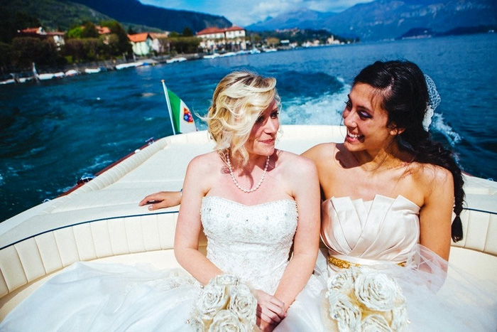 bride and maid of honor in boat on lake como