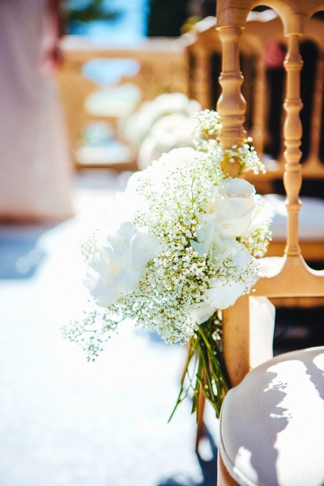 flowers on ceremony chairs