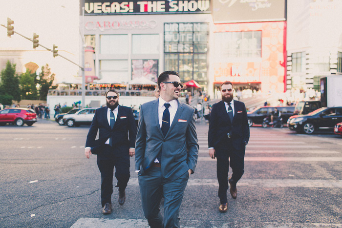 groomsmen walking through Vegas