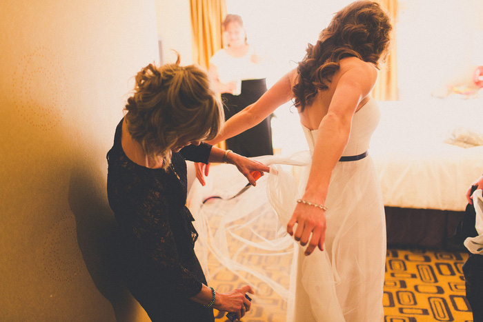 bride adjusting dress
