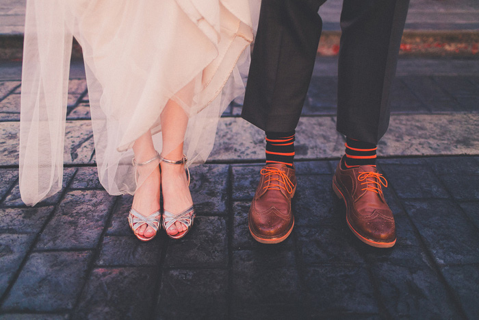 bride and groom showing off their shoes