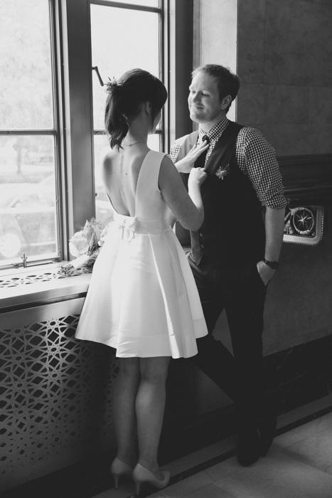 bride adjusting groom's tie