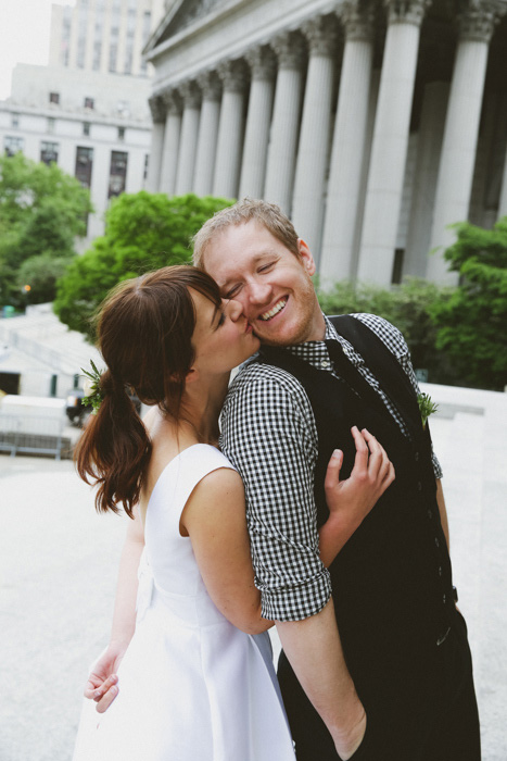 bride kissing groom on the cheek